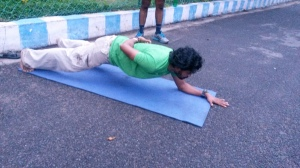 Vallabh demonstrates how to do a single hand plank